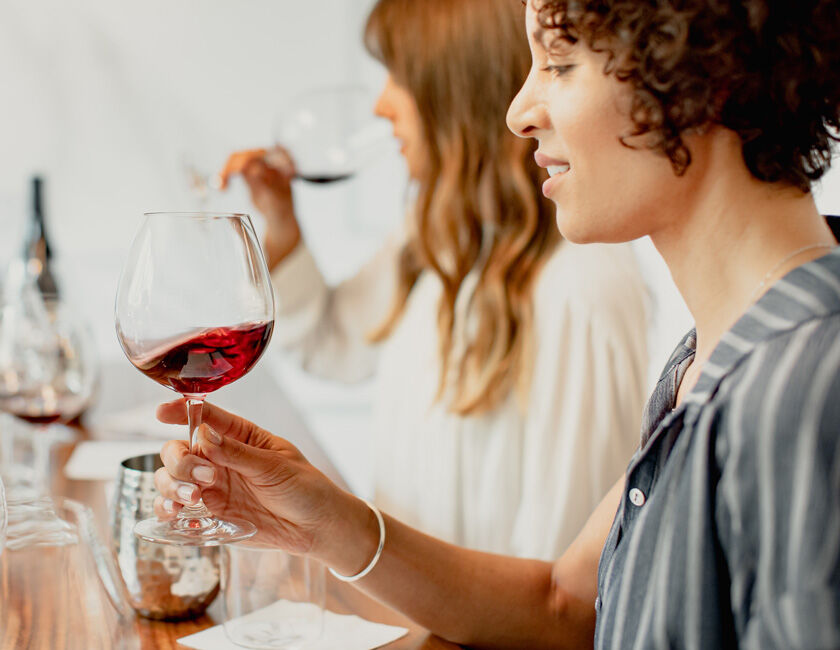 woman enjoying an etude pinot noir wine tasting event